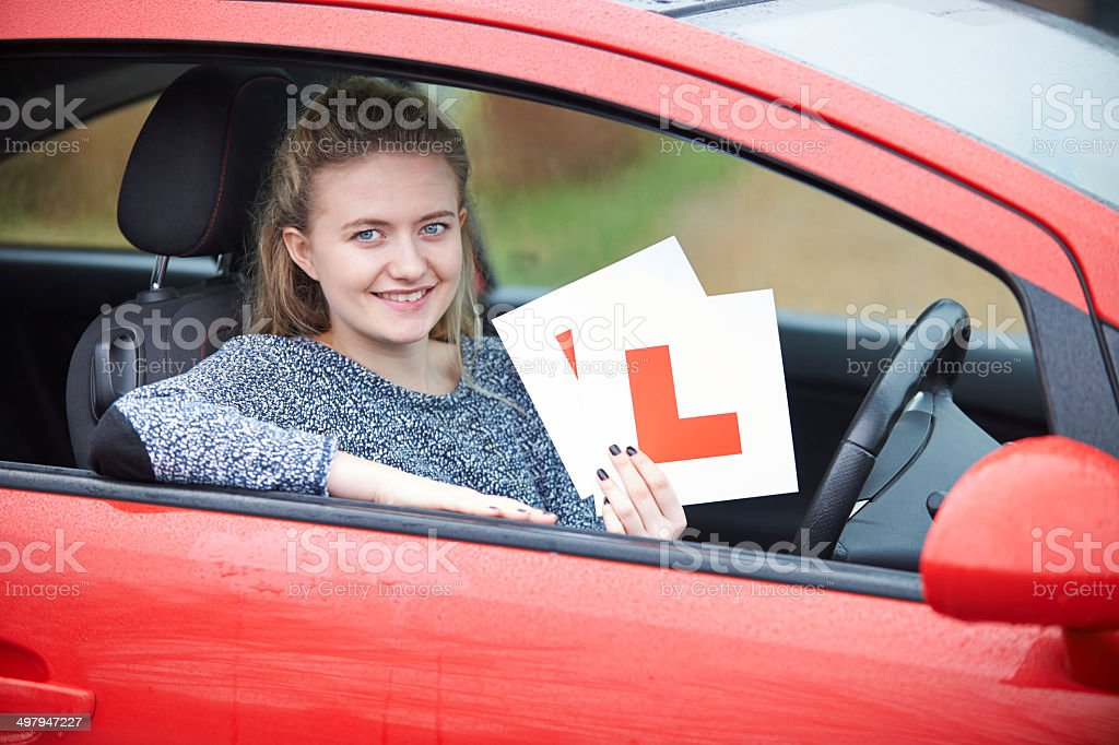 Teenage Girl Passing Driving Exam stock photo
