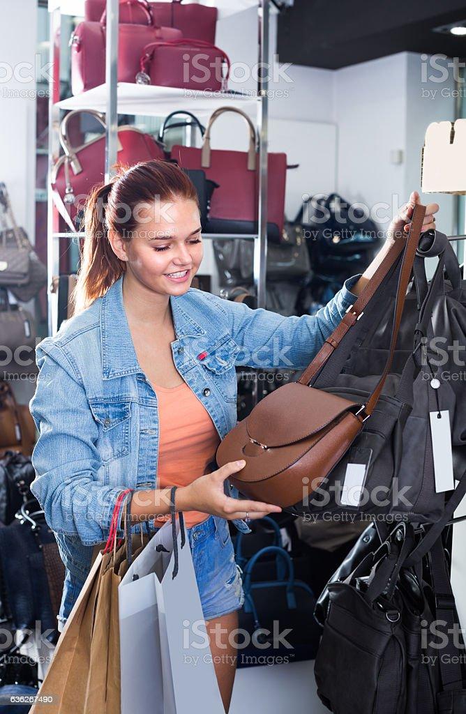 teenage girl picking  handbag stock photo