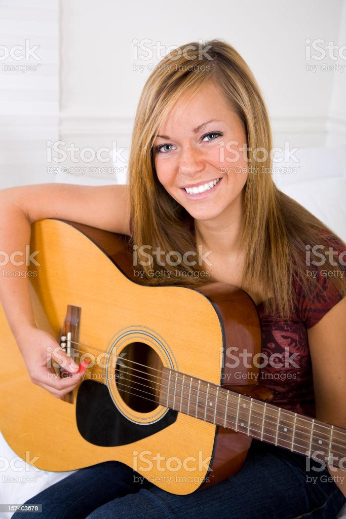 Teenage Girl Playing a Guitar royalty-free stock photo