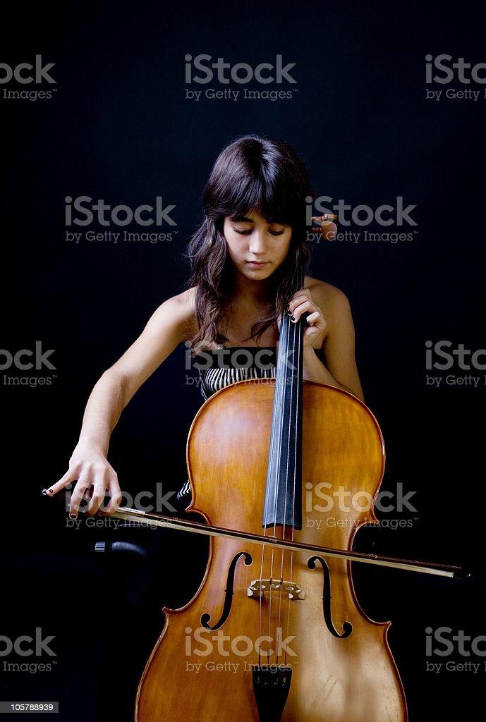 Teenage girl playing cello stock photo