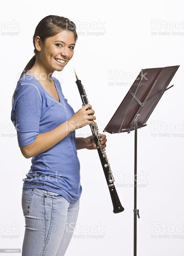 Teenage Girl Playing Clarinet stock photo