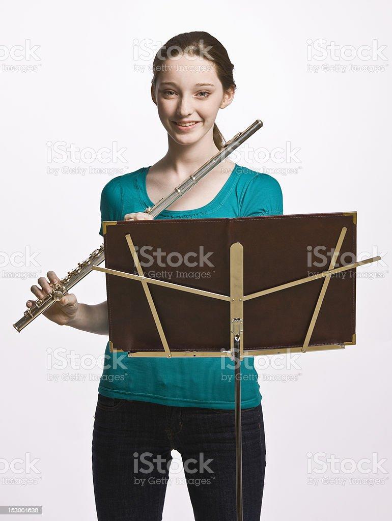 Teenage Girl Playing Flute stock photo