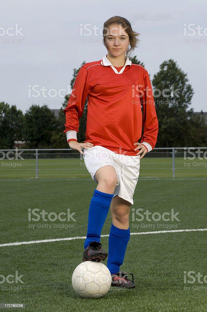 teenage girl playing soccer royalty-free stock photo