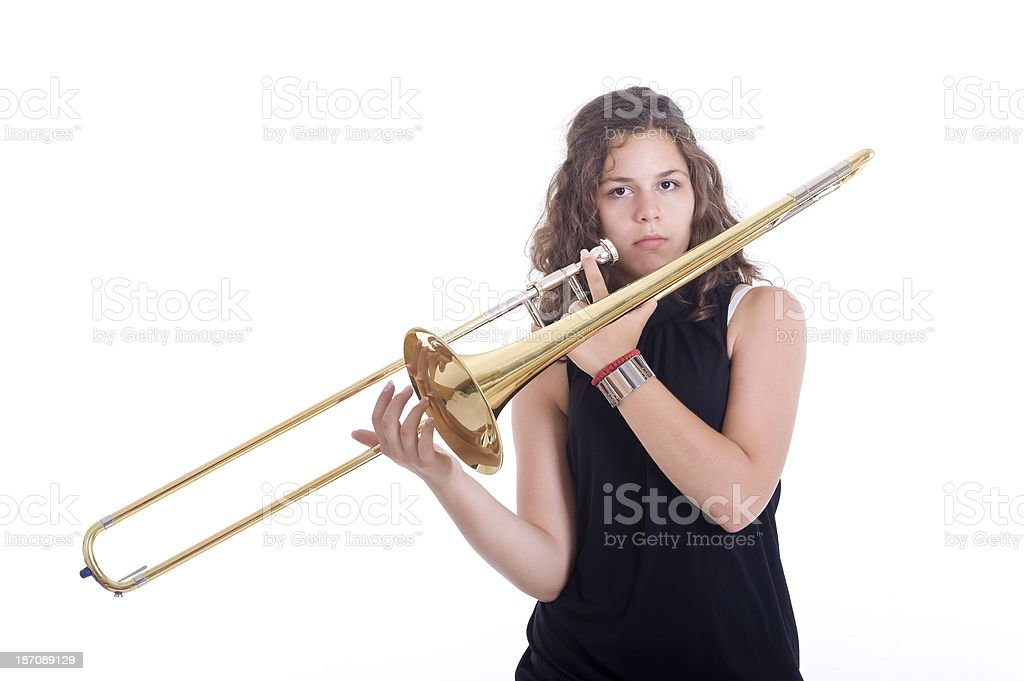 Teenage girl playing the trombone royalty-free stock photo