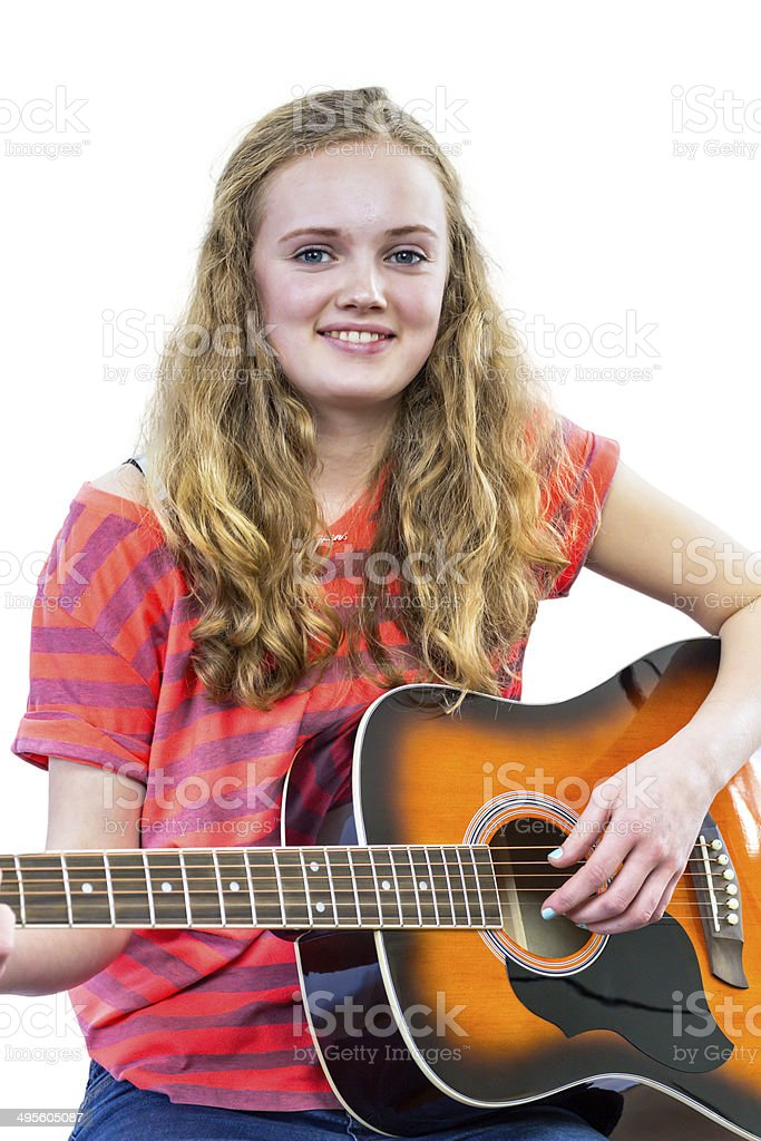 Teenage girl plays guitar stock photo