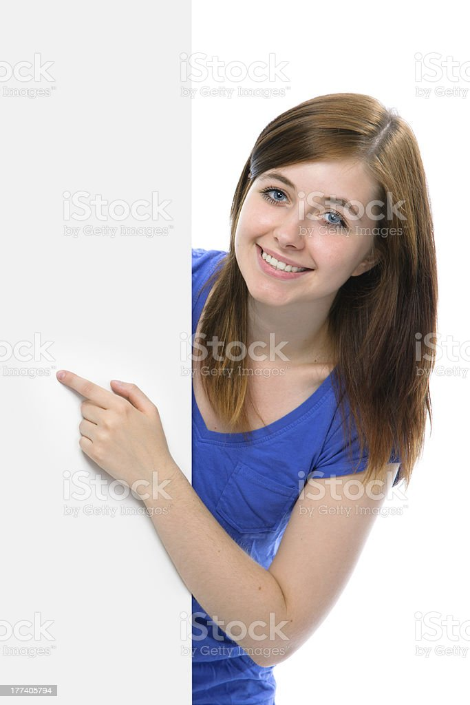 teenage girl points her finger at a blank board royalty-free stock photo