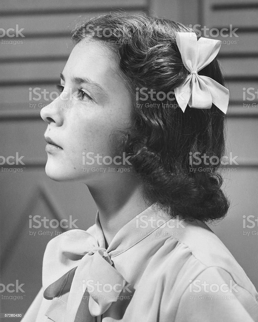 Teenage girl (14-15) posing, (B&W), close-up, portrait royalty-free stock photo