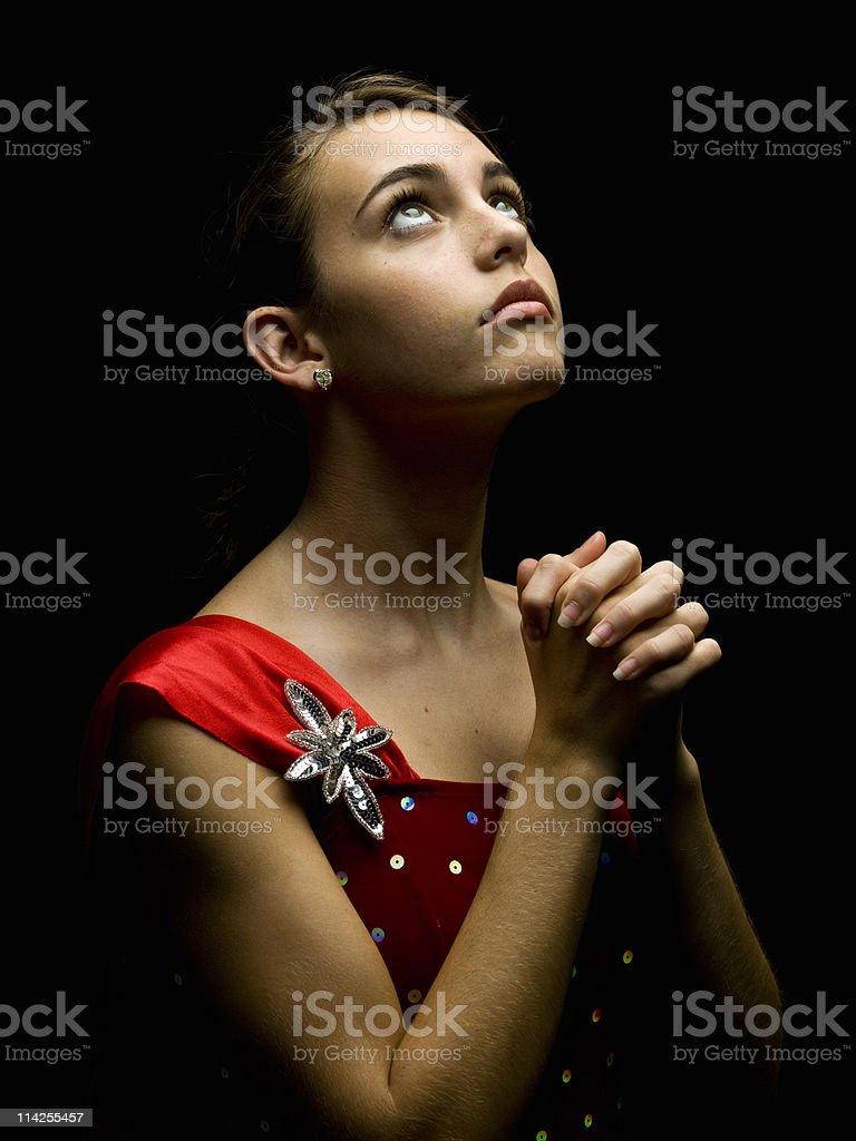 Teenage girl praying royalty-free stock photo