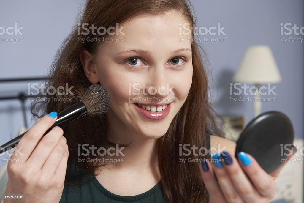 Teenage Girl Putting On Make Up stock photo