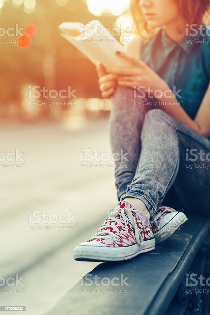 Teenage girl reading a book stock photo