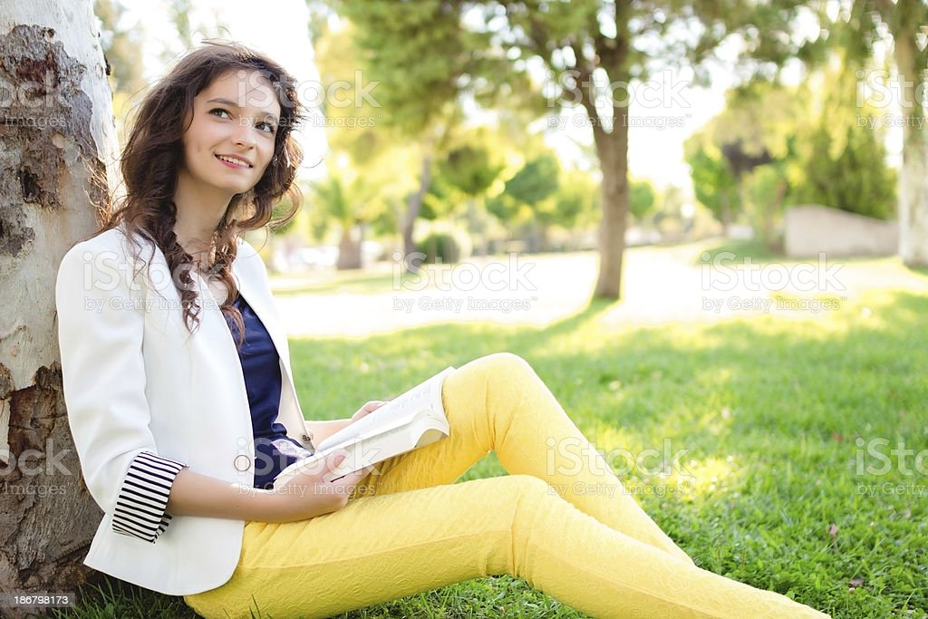 Teenage girl reading book royalty-free stock photo