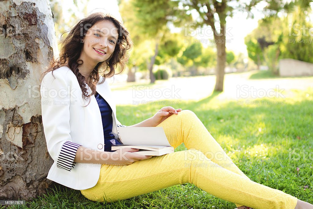 Teenage girl reading book royalty-free stock photo