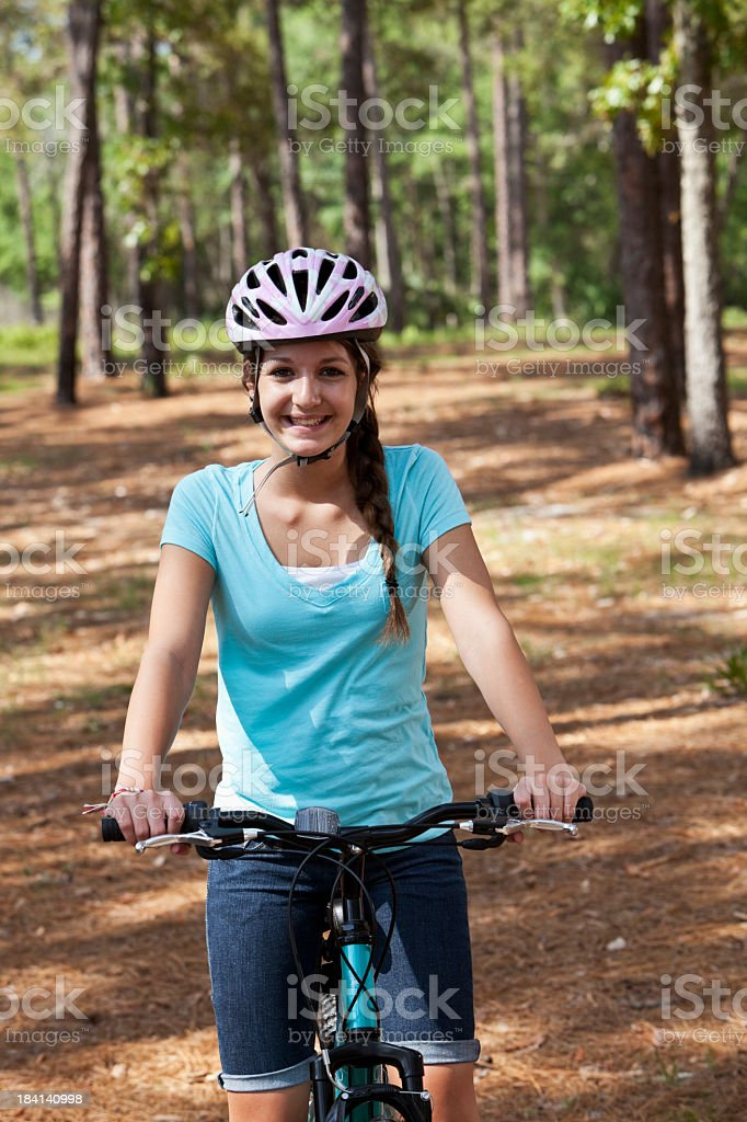 Teenage girl ridiing bike stock photo
