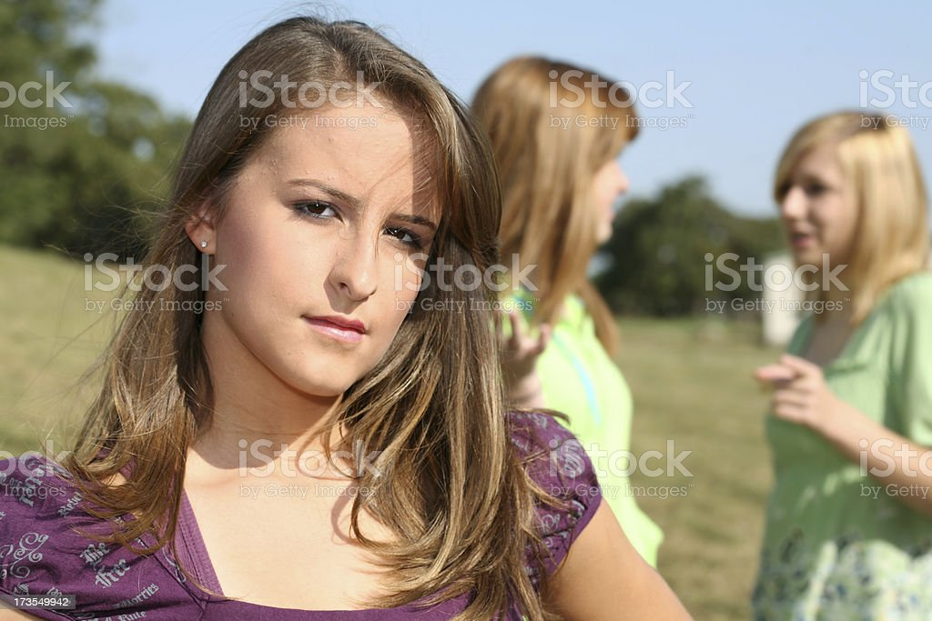 Teenage Girl Seperated From Her Former Friends royalty-free stock photo