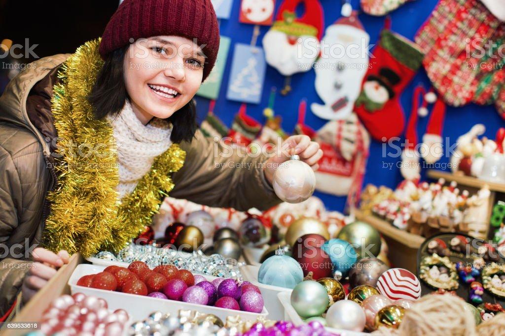 Teenage girl shopping at festive fair before Xmas stock photo