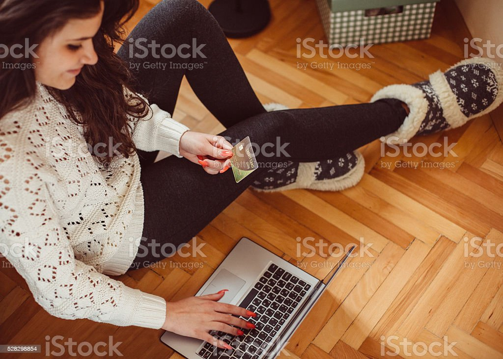 Teenage girl shopping online from home stock photo