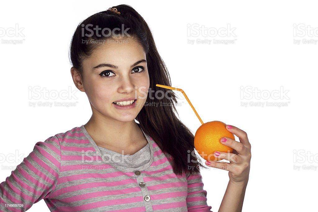 Teenage girl showing organic orange juice royalty-free stock photo