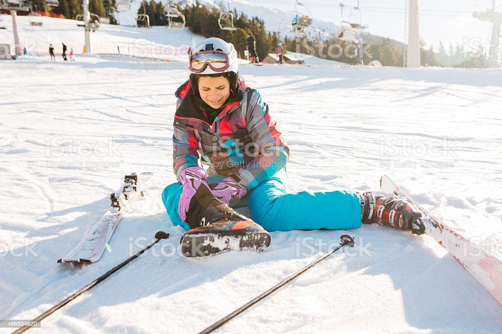 Teenage girl skiing in Italian Alps. stock photo