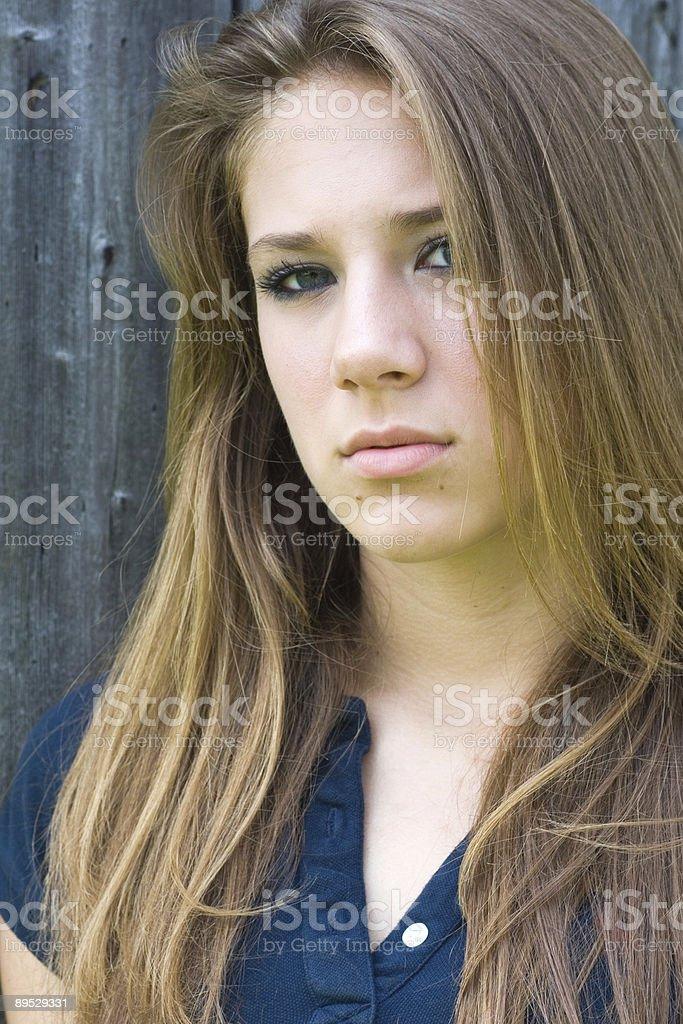 Teenage girl stares stock photo