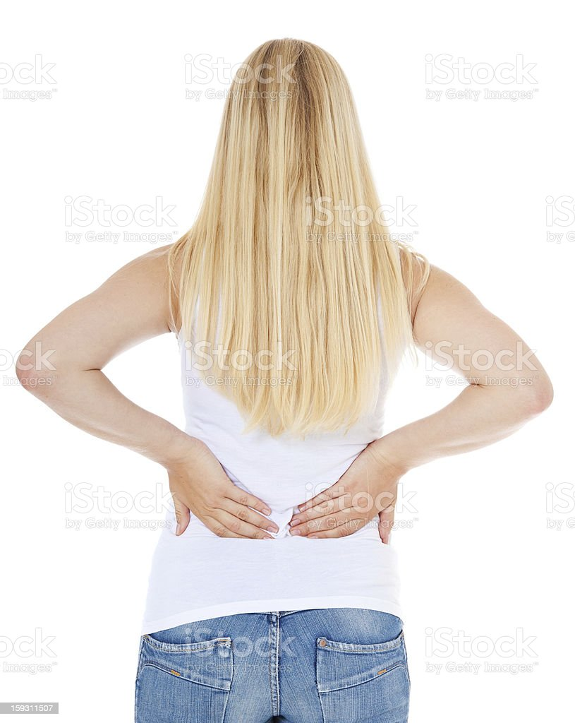 Teenage girl suffers from back pain royalty-free stock photo