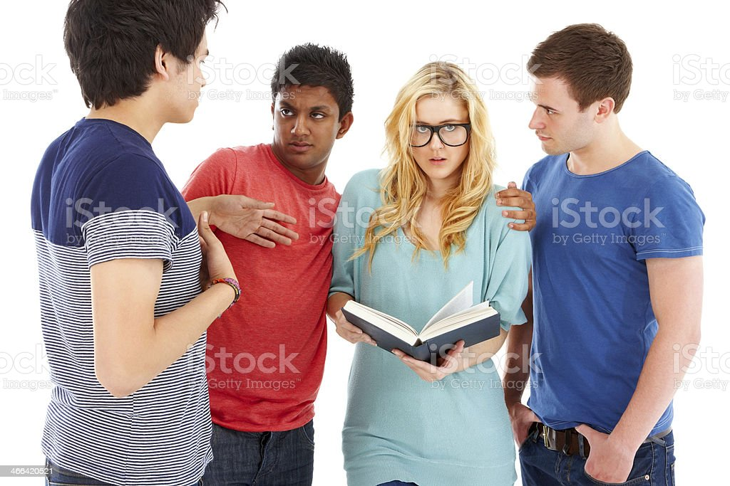 Teenage girl surrounded by classmates royalty-free stock photo