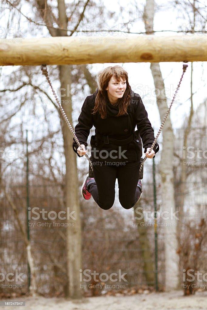 Teenage girl swinging royalty-free stock photo