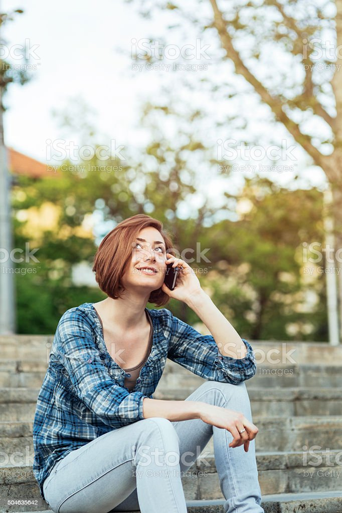 Teenage girl talking on a cell phone stock photo