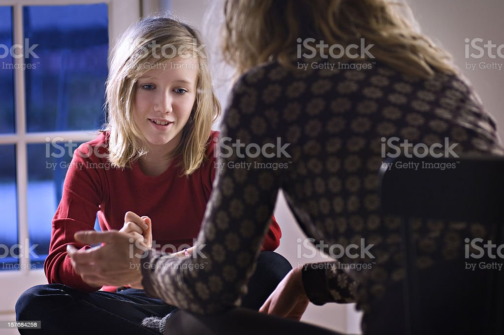 Teenage Girl Talking To a Counsellor. royalty-free stock photo