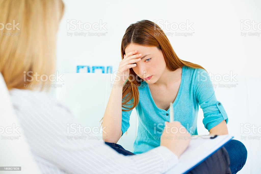 Teenage Girl Talking to Counselor. royalty-free stock photo