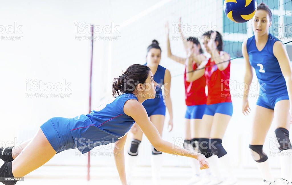 Teenage girl team playing volleyball. stock photo