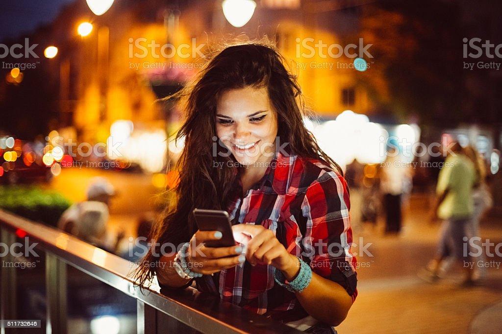 Teenage girl texting stock photo