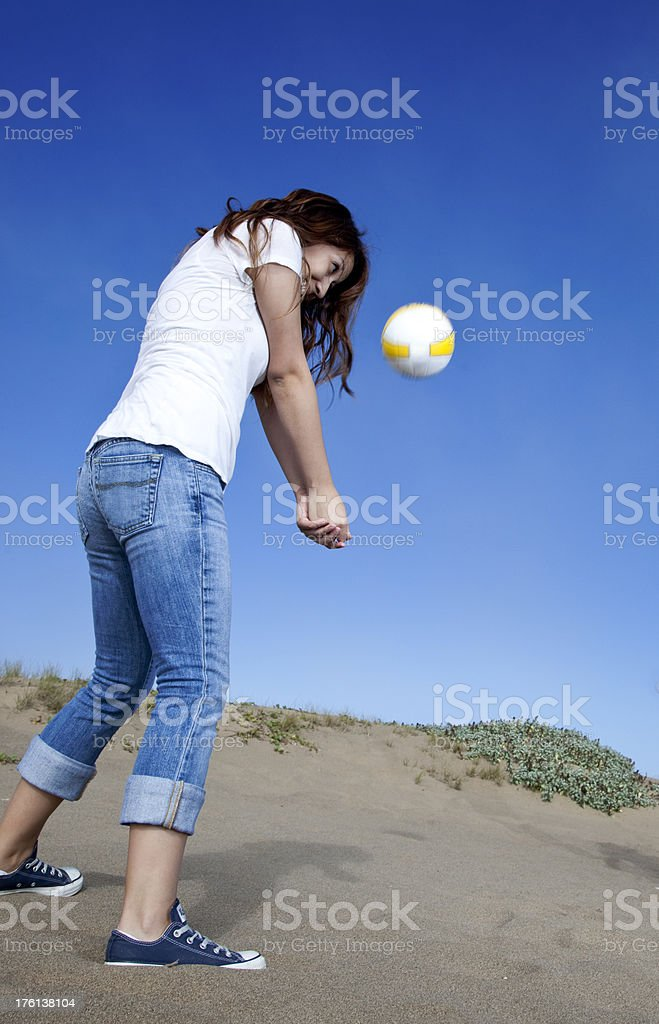 teenage girl throwing basket ball in the air stock photo