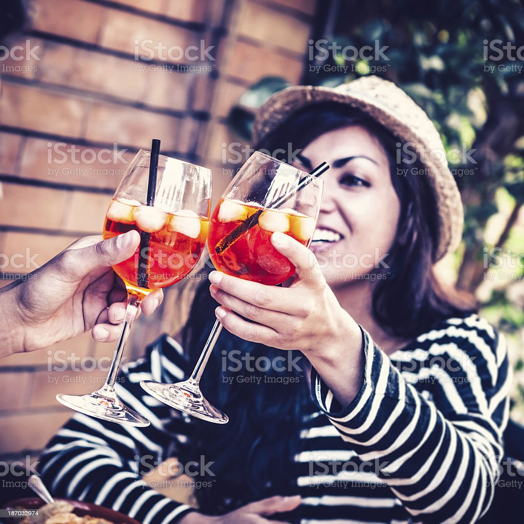 Teenage Girl Toasting with Alcoholic Drink, Italian Spritz royalty-free stock photo