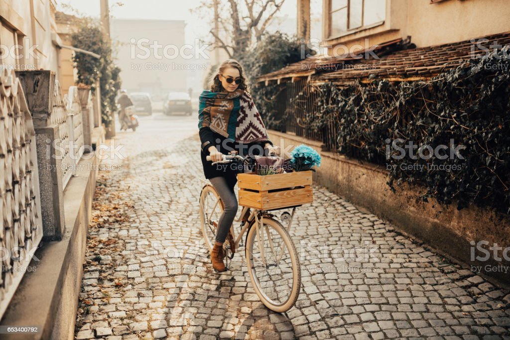 Teenage girl took the oportunity to ride her bike in the cold autumn stock photo