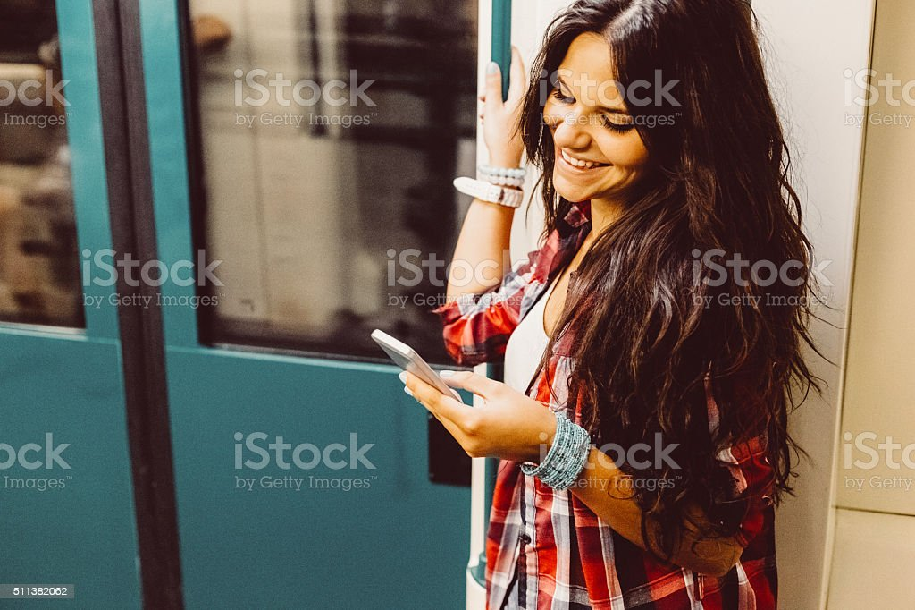 Teenage girl travelling in the subway train stock photo
