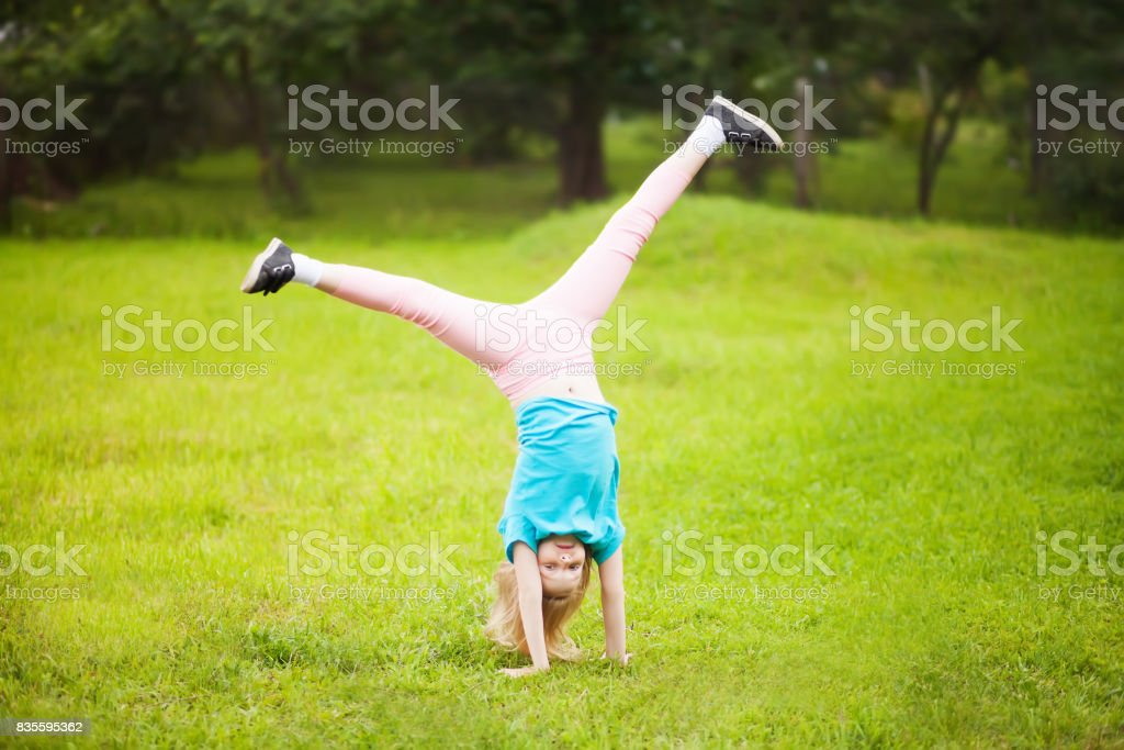teenage girl  tumbling stock photo