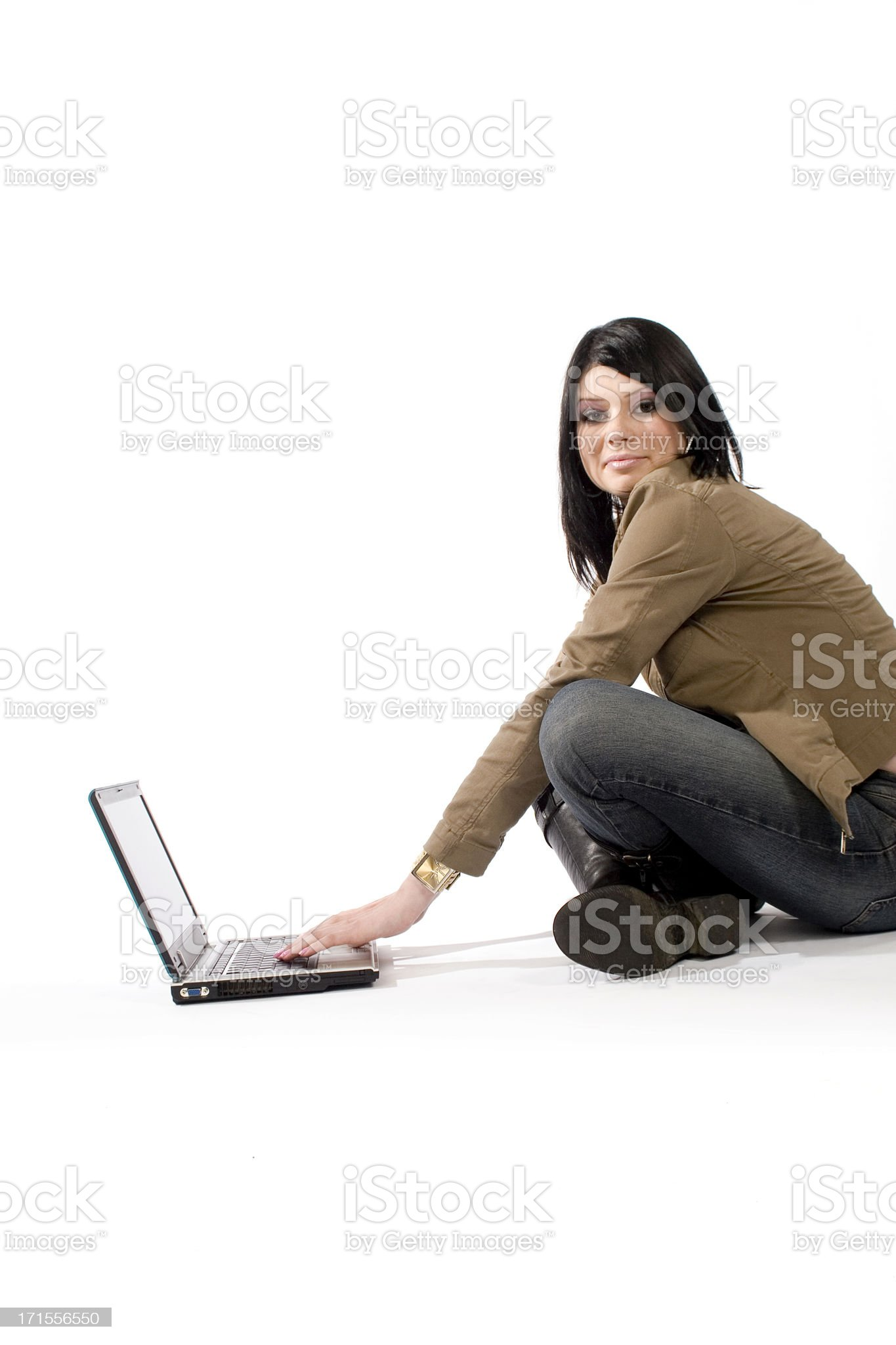 Teenage girl using a laptop royalty-free stock photo
