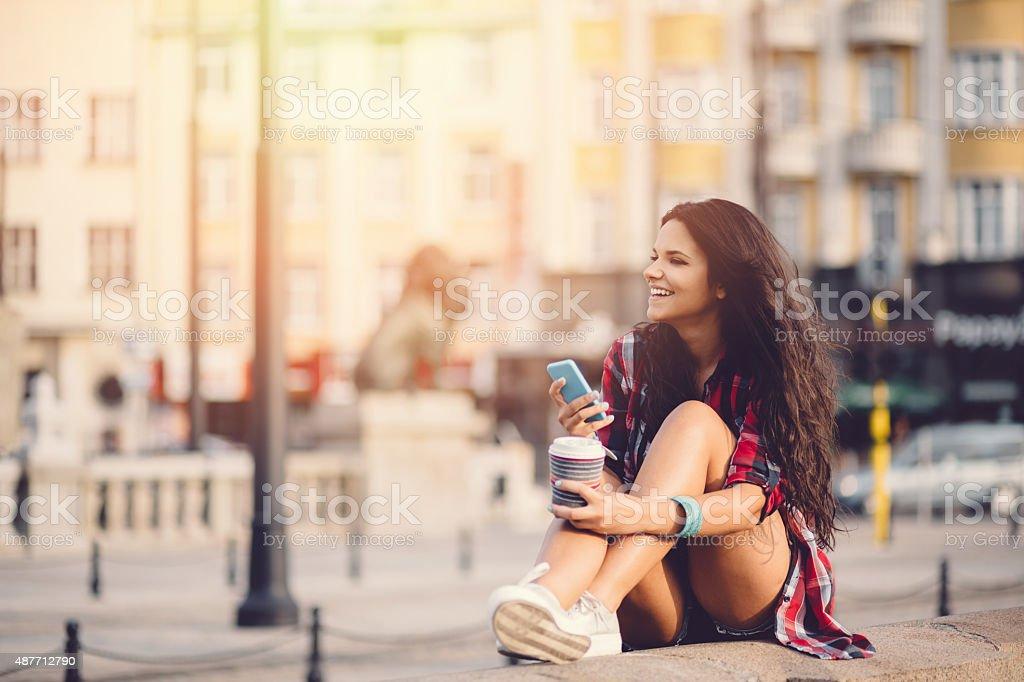 Teenage girl using smartphone in the city stock photo