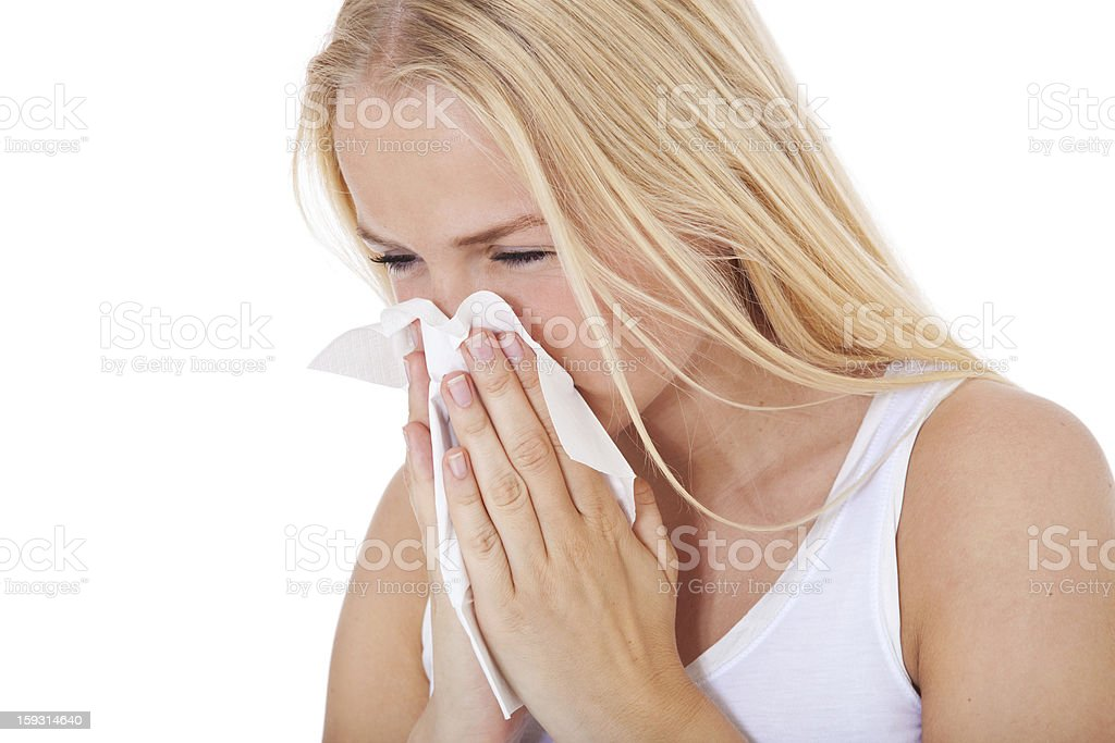 Teenage girl using tissue royalty-free stock photo