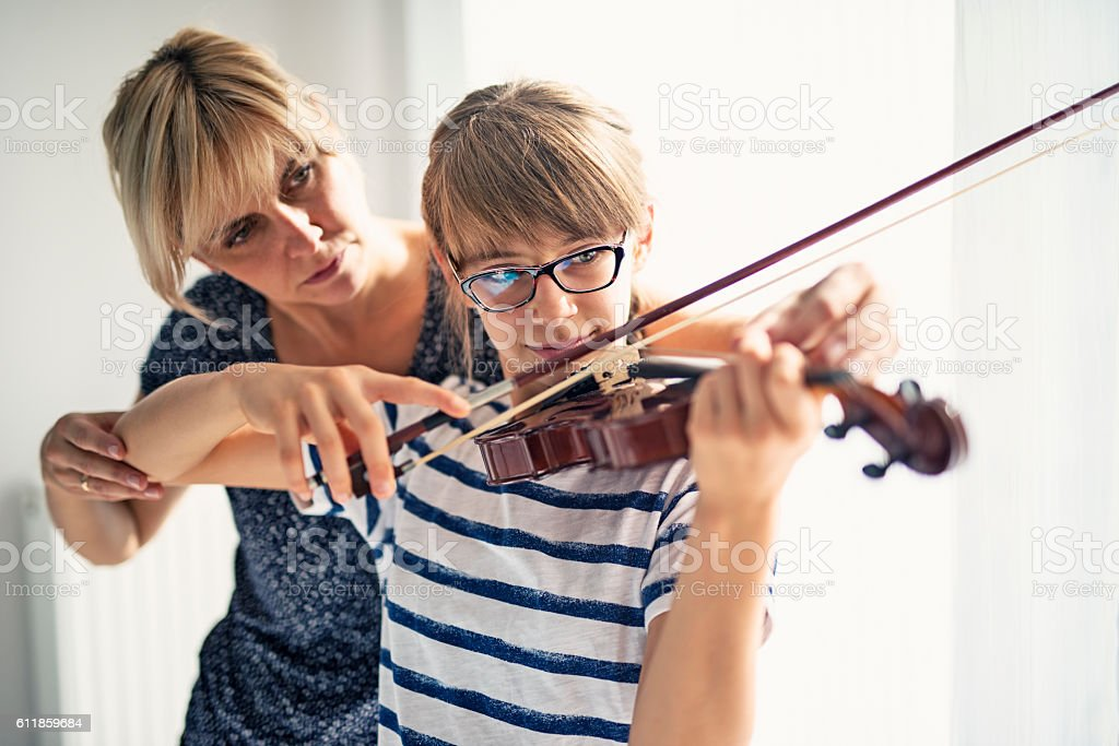 Teenage girl violin lesson stock photo