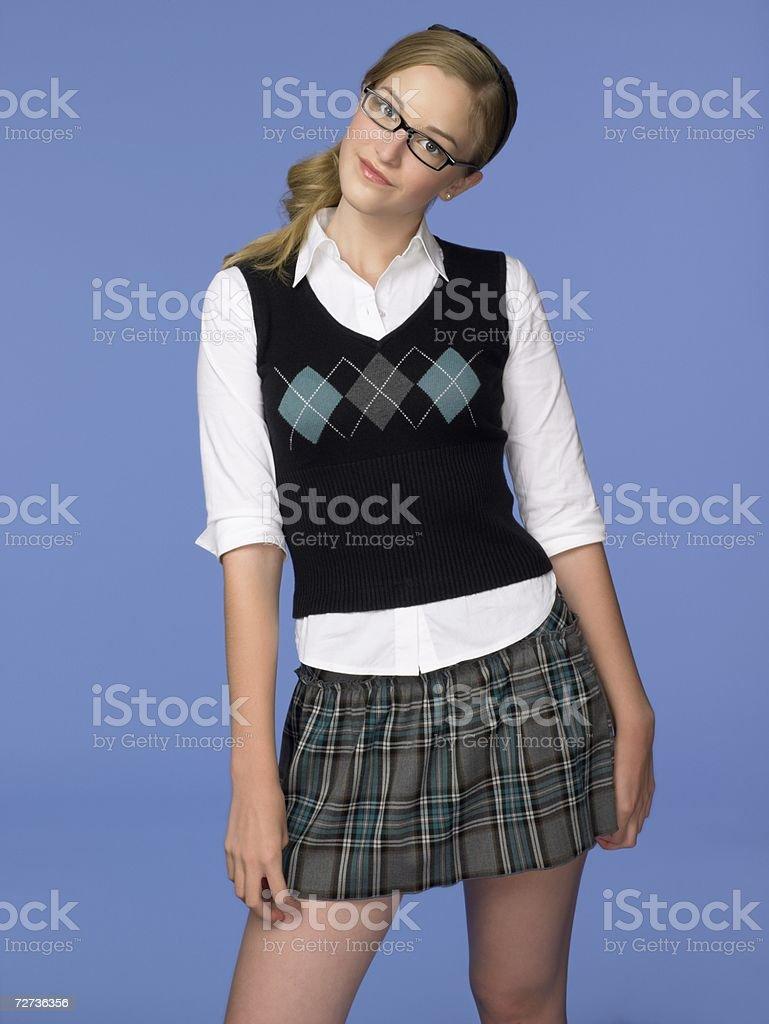 Teenage girl wearing a school uniform royalty-free stock photo