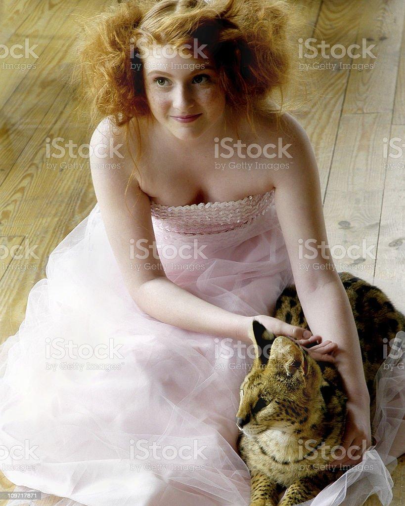 Teenage Girl Wearing Prom Dress and Petting Cat stock photo