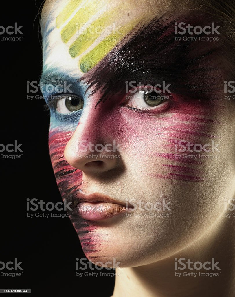 Teenage girl (15-17) wearing stage makeup, portrait, close-up stock photo