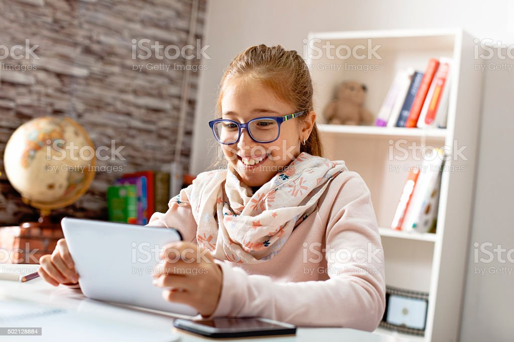 Teenage Girl With a Tablet Computer stock photo