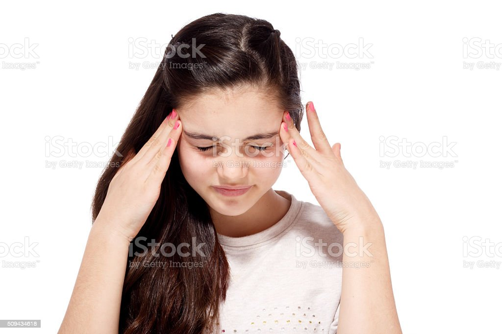 Teenage girl with an awful migraine stock photo