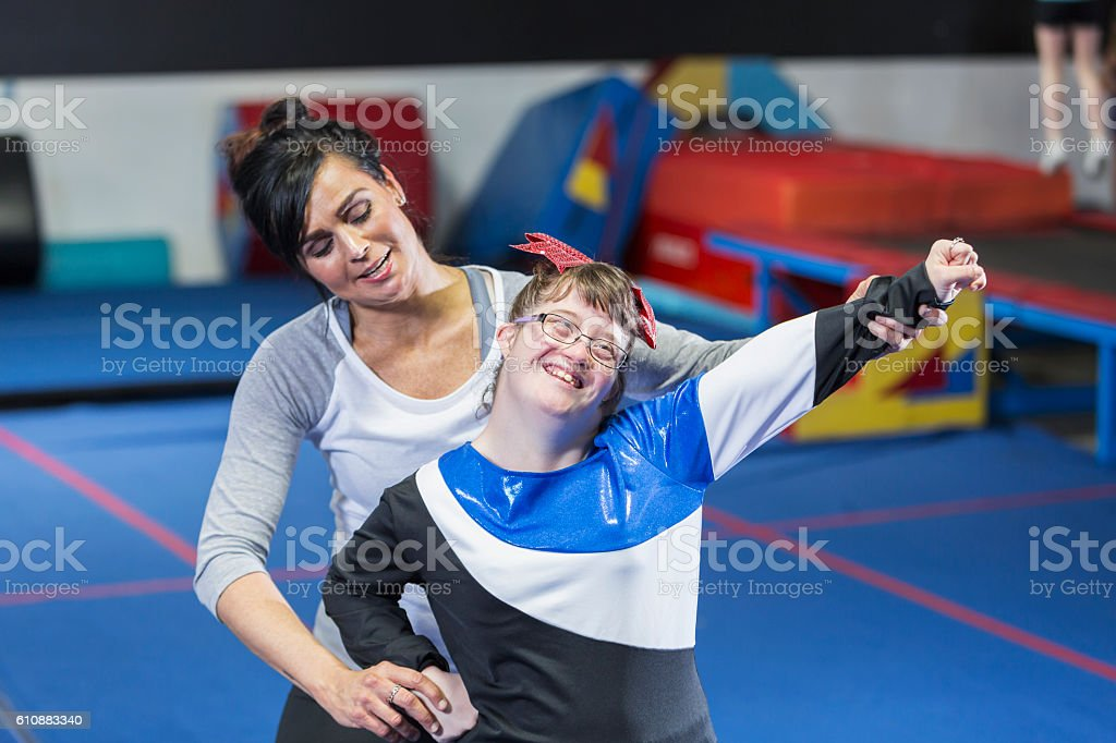 Teenage girl with down syndrome on cheerleading team stock photo