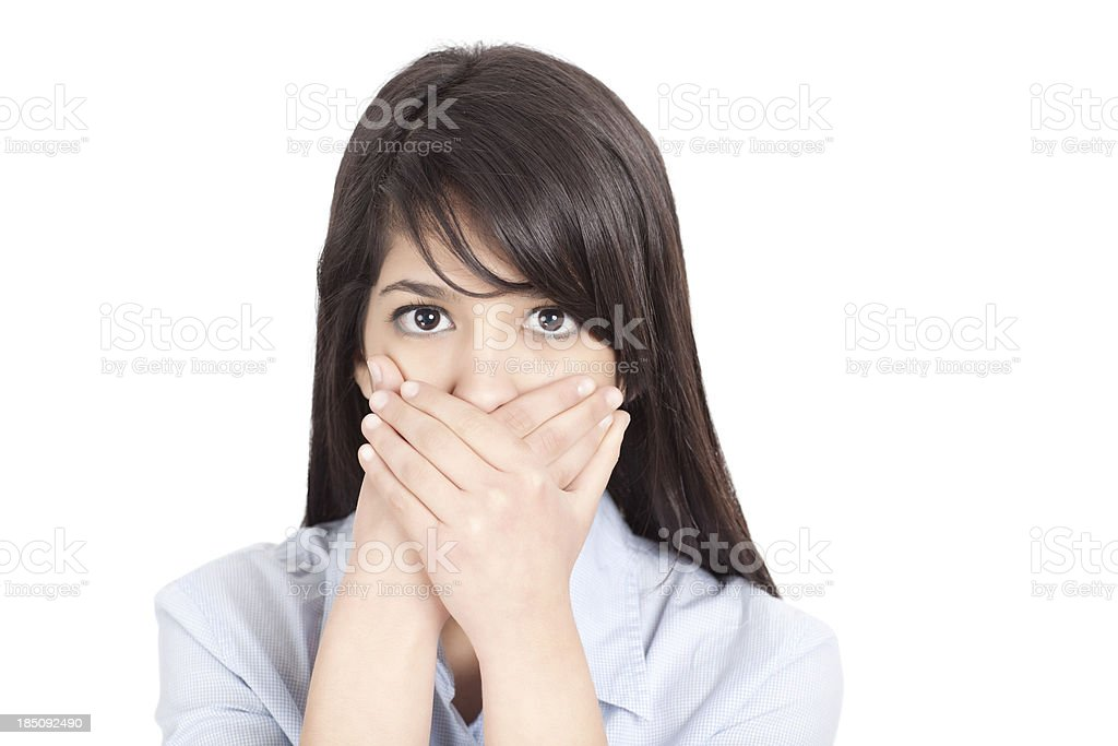 Teenage girl with hands on mouth stock photo
