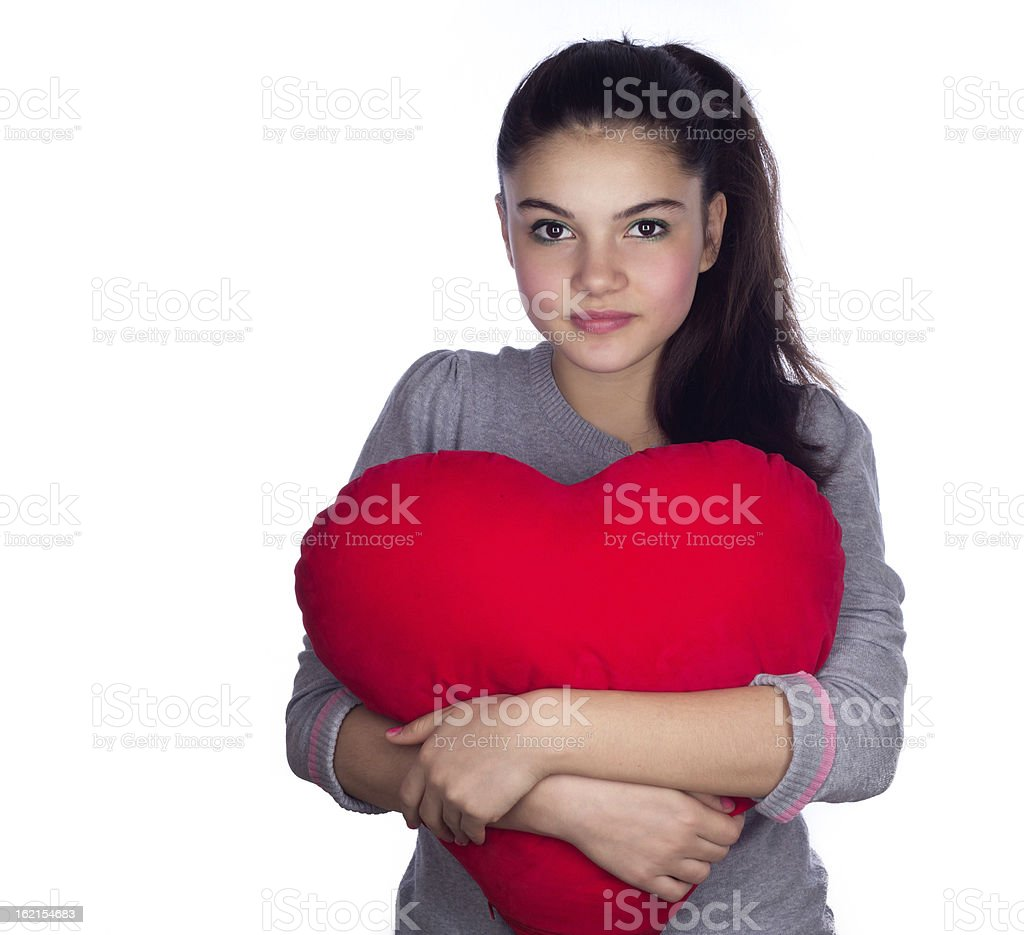 Teenage girl with  heart red pillow royalty-free stock photo