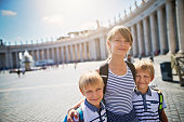 Teenage girl with her brothers visiting St. Peter's Square