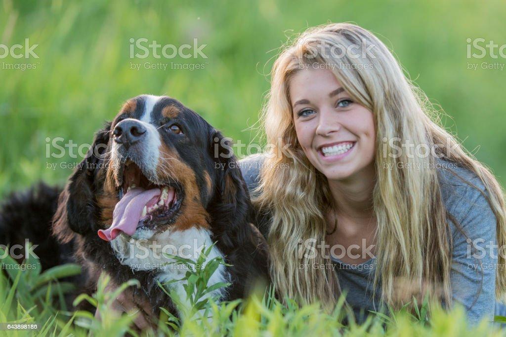 Teenage Girl with Her Dog stock photo